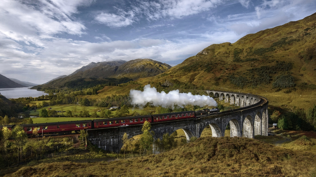 United Kingdom, Scotland, Highland, Glenfinnan, A830, Glenfinnan Viaduct, Steam train passing viaduct